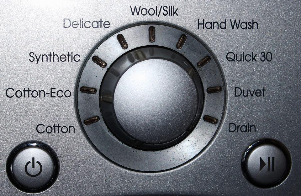 Wasmachine knop met allerlei opties